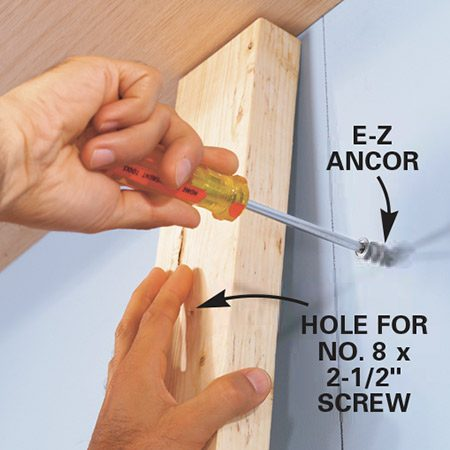 <b>Photo 7: Build the sides</b></br> <p>Rip 3/4-in. oak plywood to 11-7/8 in. and then drill 1/4-in. holes for standard shelf clips. Use a strip of 1/4-in. pegboard as a template for the shelf clip holes. Drill the holes, positioning the template to the bottom of each piece to ensure the shelves will be level when installed.</p>