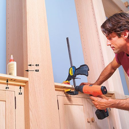 <b>Photo 21: Attach the extension assembly </b></br> <p>Fasten the front cabinet top extensions with your pocket hole jig. Nail a 3/4-in. x 3/4-in. strip to the top of the face frame and glue the extension to this for added support.</p>