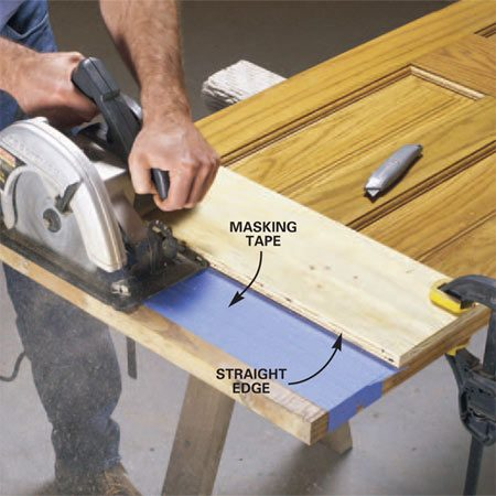 <b>Photo 1: Door trimming technique</b></br> Put a sharp blade in your circular saw, score the cut line and clamp on a straight edge for a guide.