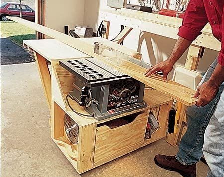 <b>Table saw module in action</b></br> This module stores the saw under the bench, then swings out so you can rip long boards.