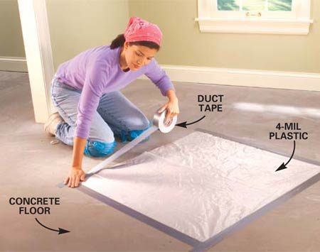 <b>Photo 1: Use plastic to test for moisture in concrete</b></br> Test for excess moisture in concrete floors by sealing the edges of a 3-ft. square of plastic sheeting to the floor with duct tape. Wait 24 hours before you peel back the plastic to check for moisture. Water droplets on the plastic or darkened concrete indicate a possible problem with excess moisture. Ask your flooring supplier for advice before installing a wood floor.