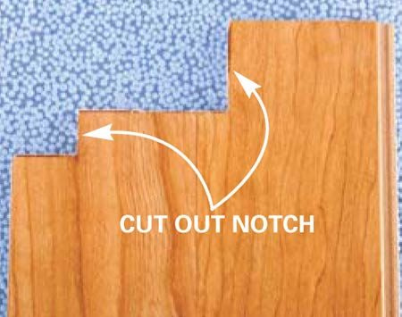 <b>Notched plank detail</b></br> The notch in the flooring board has been cut to fit the doorjamb.