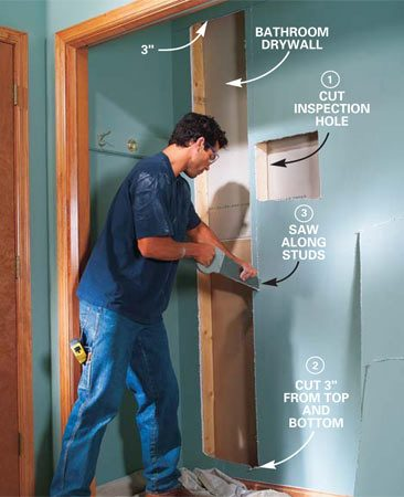 <b>Photo 8: Cut out the closet drywall</b></br> Remove the closet rod and shelf from the closet behind the bathroom wall. Cut a rough inspection hole, then check for electrical cables by peering down into the stud spaces with a flashlight. Cut horizontally between the studs 2 to 3 in. from the ceiling and the baseboard. Then cut out drywall using the studs as a guide.