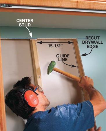 <b>Photo 9: Prepare the framing. </b></br> Draw a line along the studs on the backside of the drywall, and then use a 2-lb. maul to pound the side studs over until each opening is 15-1/2 in. wide. Use the line as a guide to tell when the stud has moved about 1 in. Pound mostly at the very top and bottom of the stud to slide it along the plates. Smaller taps between the top and bottom will loosen the grip of drywall screws or nails. Toe-screw the studs to the plates with 3-in. screws and cut off the overhanging drywall edge.