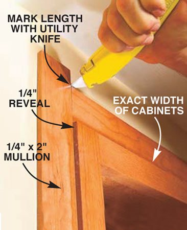 <b>Photo 19: Install the trim</b><br/>Cut the 1/4-in. thick x 2-in. wide mullion strips the exact width of the top and bottom of the cabinets and nail them on with 1-1/2 in. brad nails. Then mark the side trim for length and cut and nail it to the side studs.