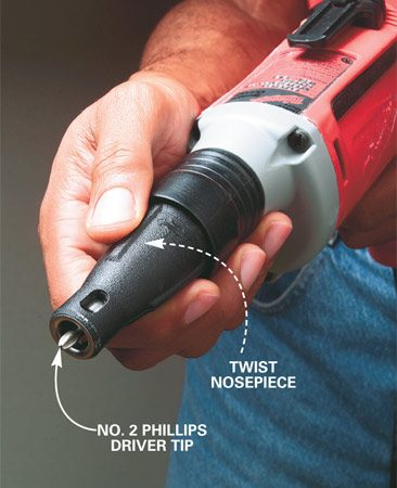 <b>Photo 1: Adjust screw gun depth</b></br> Twist the nosepiece on the screw gun to adjust the screw depth. Practice driving screws on a scrap of drywall backed by wood until you get the setting just right.