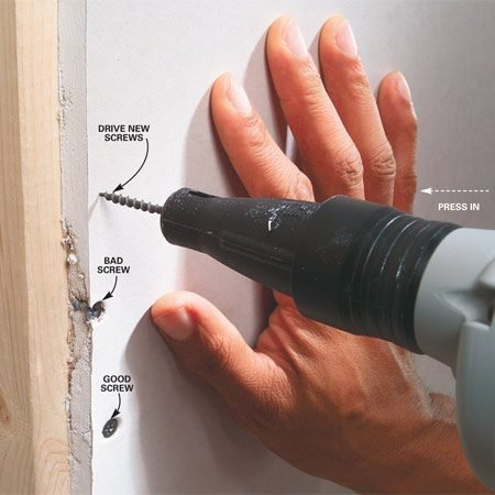 <b>Photo 1: Push drywall against studs</b></br> Press against the drywall while you drive in screws. Don't release the pressure until you've driven two or three screws into the framing to distribute the load.