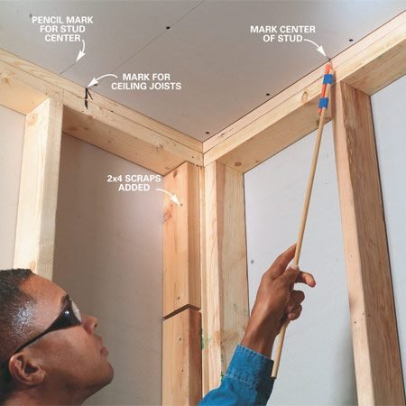 <b>Photo 1: Mark studs and joists</b></br> Avoid missed screws by marking all framing members before you start hanging drywall. Mark the ceiling framing on the top plate of the walls. Avoid climbing a ladder by taping a pencil to the end of a stick and using this to mark the framing. Then after the ceiling drywall is hung, mark the centers of the wall studs on the ceiling drywall.