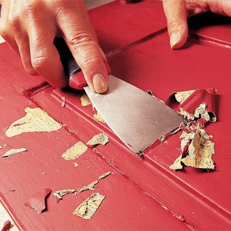 <b>Photo 1: Scrape off loose and cracked paint</b></br> Remove all loose or cracked paint with a stiff putty knife. Work in various directions to get underneath the loose paint.