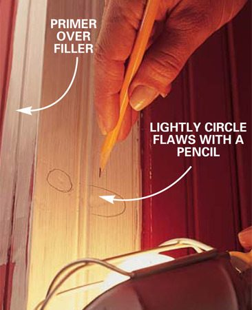 <b>Photo 5: Mark imperfections in the wall</b></br> Hold a utility light close to the surface, and circle any imperfections with a pencil. Fill, sand and spot-prime these areas. Finally, lightly sand the entire surface with the 180-grit paper to ensure that the new paint will stick.