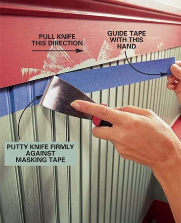 <b>Photo 12: Tape off finished areas</b></br> Apply painter's masking tape to protect finished surfaces before brushing on the second color. Carefully position the tape and push it tight against the surface with a stiff putty knife. Be sure the paint underneath has thoroughly dried.