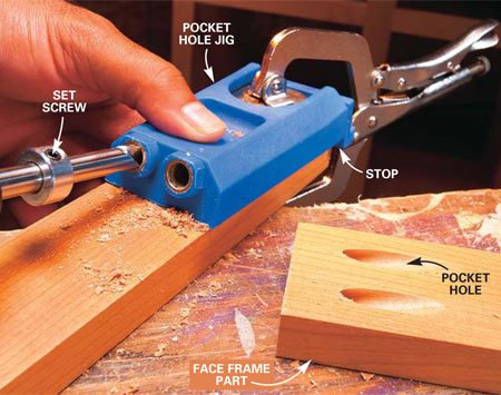 <b>Photo 3: Clamp and drill</b></br> Slide the stop against the end of the board, center it and clamp the jig in place. Bore two pocket holes for the screws. When you're building a cabinet face frame like this, drill the pockets parallel to the grain of the wood as shown.
