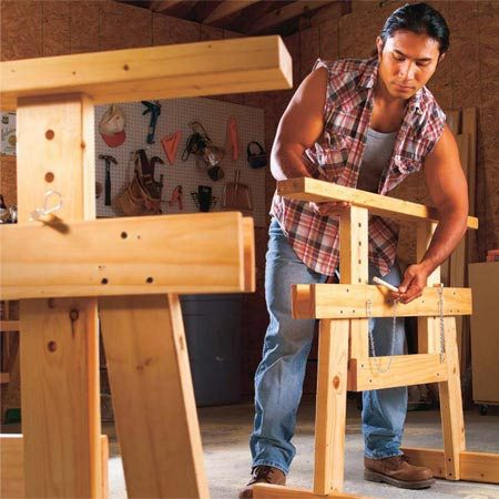 <b>Adjustable sawhorses</b></br> A pair of dowel pins allows you to raise and lower the top to find a comfortable working height.
