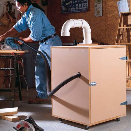<b>Muffler box in action</b></br> A carpet-lined box muffles the vacuum noise.  Casters allow you to roll it right to your work area.