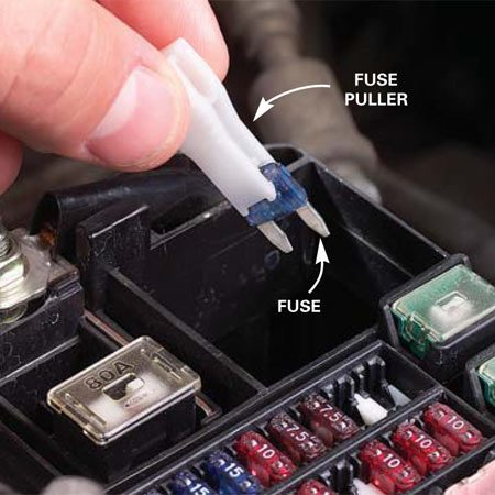 <b>Photo 5: Pull the fuse</b></br> Remove the fuse that's labeled for the device that's not working, for example, the fan, radio, lighter or marker lights. Use a needle-nose pliers or a fuse puller (available at auto parts stores).
