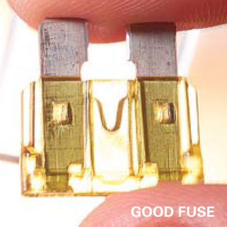 <b>Good fuse</b><br/>In a good fuse, the wire between the two sides is still whole.
