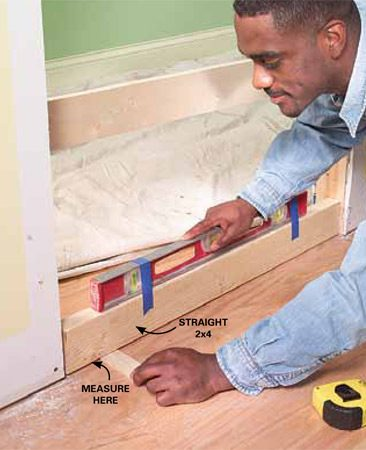 <b>Photo 1: Check the floor</b></br> Check the floor for level and the jambs for plumb. Measure the exact amount the floor is off level. The opposite jamb must be cut by this much to level the door in the opening.