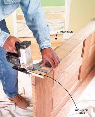 <b>Photo 3: Trim the jamb with a jigsaw</b></br> Mark and cut the jamb on the high side with a jigsaw (remove any packaging strips at the bottom of the jambs). If you cut more than 1/4 in. from the jamb, you may need to trim the bottom of the door so it conforms to the floor slope.