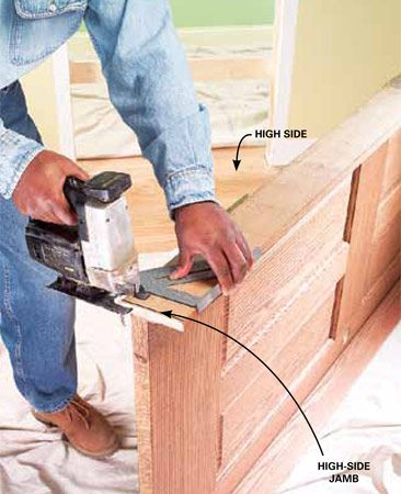 <b>Photo 2: Trim the jamb</b></br> Mark and cut the jamb on the high side with your saw (remove any packaging strips at the bottom of the jambs). If you cut more than 1/4 in. from the jamb, you may need to trim the bottom of the door so it conforms to the floor slope.
