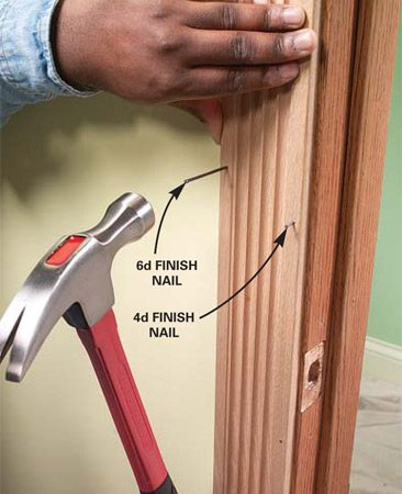 <b>Photo 10: Attach the trim</b></br> Nail the trim to the door frame with No. 4 finish nails. Nail the trim to the framing with No. 6 finish nails.