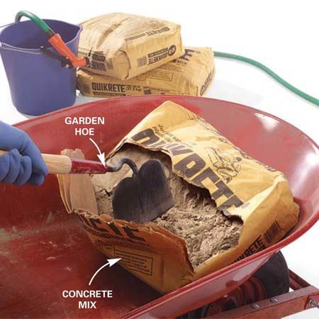 <b>Photo 1: Slice and dump the bag</b></br> Set the bag of concrete mix in one end of the wheelbarrow and slice it open with your hoe. Dump the mix from the bag and pull out the paper bag.