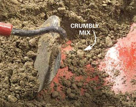 <b>Photo 4: Too dry</b></br> Drag the hoe through the mix to make a trough. The mix is too dry if the sides of the trough are crumbly and the concrete falls in chunks when you disturb it. Add water one cup at a time, mixing between each addition.
