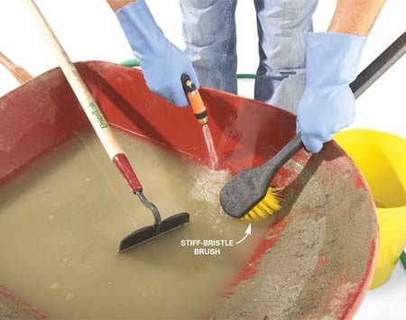 <b>Photo 7: Wash your tools</b></br> Scrub the wheelbarrow and tools with a stiff-bristle brush before the concrete starts to harden. Rinse well.