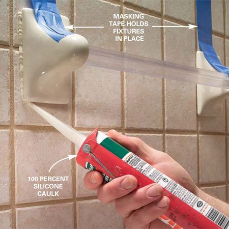 <b>Use caulk as glue</b></br> <p>Spread caulk over the back of the  fixture, then hold it in place with plenty of tape. Caulk the edges of the  fixture after the caulk behind the fixture sets up. If possible, use caulk that  matches the grout color.</p>