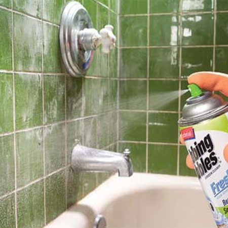 <b>Photo 7: Spray a cleaner on the shower tile</b><br/>Coat the entire tiled surface (grout, caulk and all) with an all purpose cleaner that attacks soap scum. Wait 5 to 10 minutes to allow the product to work, which saves your scrubbing elbow.