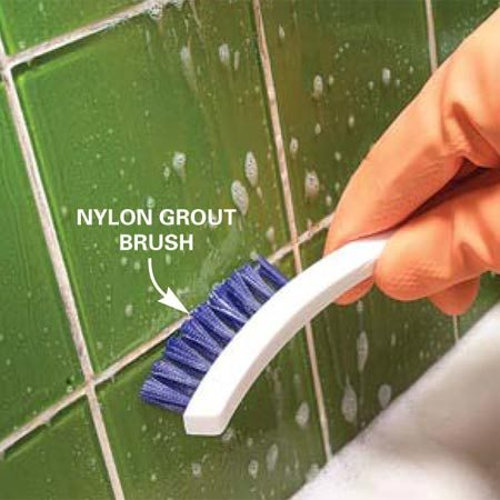 <b>Photo 9: Remove build up on grout lines</b><br/>Remove stains and deposits on grout or caulk by lightly scrubbing back and forth with a grout brush or old toothbrush. Reapply product as needed.