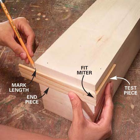 <b>Photo 5: Fit the trim</b></br> Using a short test piece, fit the end piece and mark and cut it to fit. Use the test piece to accurately position the trim while you glue and nail it to the box. Cut the miter on the long front piece of trim, fit it to the first piece, mark its length, then cut and fasten it. Repeat the steps for the other end.