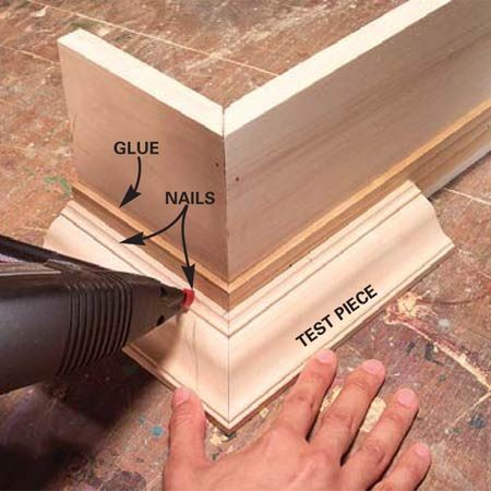 <b>Photo 7: Attach the crown molding</b></br> Flip the box upside down and prop the crown molding end piece against the box. Use the other end as a test piece to line up the miters. Mark and cut the piece to length. Smear a little glue along the bottom and tack it to the cornice with a couple of 1-in. brads.