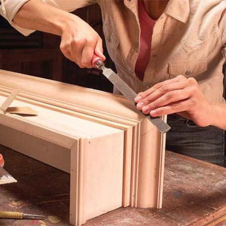 <b>Photo 10: Smooth out the profiles</b></br> Fill nail holes and any miter gaps in joints with wood filler. Sand excess wood filler and file miters as necessary to remove any wood fibers or smooth out inconsistencies in profiles.