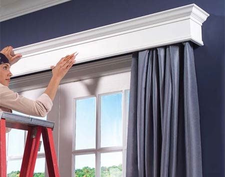 <b>Photo 12: Center the cornice </b></br> Center the cornice over the opening at the height that best covers the curtain rod and curtain. Then reach underneath and mark the bottom. Take down the cornice and extend the mark with a 4-ft. level.