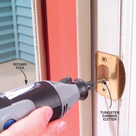 <b>Photo 1: Widen latch opening</b></br> Shave off the inside of the strike plate with a rotary tool and a metal-cutting carbide bit. Remove a small amount and test the latch by closing the door. Continue removing metal until the door latch catches.