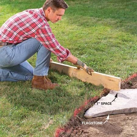 <b>Photo 3:  Dig until the flagstone is 1 in. below the sod</b></br> Remove enough dirt so that the top of the flagstone sits 1 in. below the surrounding sod. The sod cutter works well for shaving down the grade, but a flat shovel works well too.