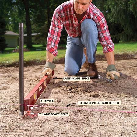 <b>Photo 4: Spread a sand base </b></br> Drive a 6-in. landscape spike beside the center pipe until it's 2 in. below the sod level. Drive six additional spikes about 3 ft. away from the center, spacing them evenly around the center. Level the top of each spike with the center one, then spread sand in the circle flush with the tops of the spikes.