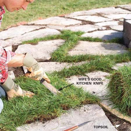 <b>Photo 9: Fill the gaps between the flagstones</b></br> Fill the spaces between the stones with topsoil to about 1/2 in. below the top. Then cut sod with a knife to fit between the stones. Press the sod firmly into the soil and keep the sod damp until it has rooted.