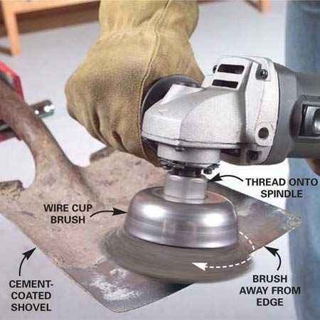 <b>Photo 1: Use a wire brush for cleaning</b></br> Clean rust and caked-on cement and dirt from garden tools with a wire cup. Secure the work with clamps or a vise. Make sure the brush is spinning away from, not into, the edge. Otherwise, the brush can catch on the edge and cause the grinder to kick back at you.