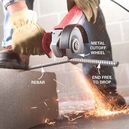 <b>Photo 3: Cut rebar</b></br> Mount a metal cutoff wheel in your angle grinder. Prop up the long side of the rebar and hold it securely. Drop the cutoff wheel through the metal, allowing the weight of the tool to do most of the work. Allow the short end to drop freely to avoid binding the blade.