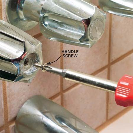 <b>Photo 2: Remove the handle screw</b></br> Remove the handle screw. Then wiggle the handle and pull it off. If the handle doesn't come off, heat it with a hair dryer to free it. Be careful; if you pull too hard, it'll break.