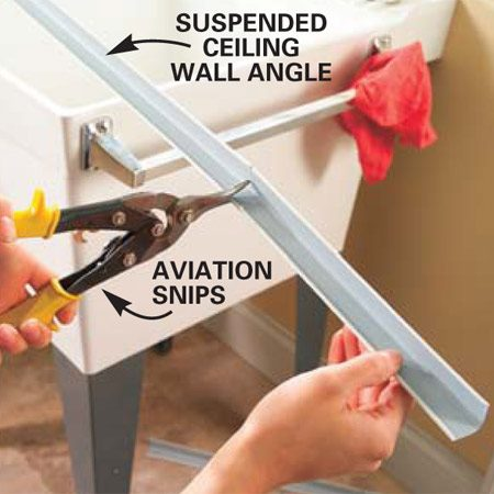 <b>Photo 1: Cut angles for the shelf</b></br> Using an aviation snips, cut two lengths of suspended ceiling channel to support the undersink shelf.