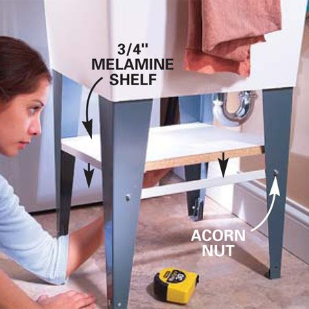 <b>Photo 3: Add the shelf</b></br> Cut a shelf from 3/4-in. Melamine board and drop it onto the angle braces. You may need to notch your shelf if the sink trap is in your way. Paint the raw edges of the board to protect them from moisture.