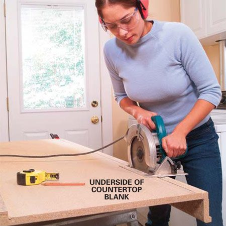 <b>Photo 1: Cut the backsplash off</b></br> Buy a 6-ft. plastic laminate countertop blank from a home center. Measure in 1-1/2 in. from the back side, and draw a straight line. Cut this section away with a circular saw equipped with a sharp blade. Trim the countertop to length, cutting from the backside. We cut ours 5 ft. long so we could support it with only two laundry table brackets. Longer tables will sag without an additional bracket. Space the brackets no farther than 32 in. apart.