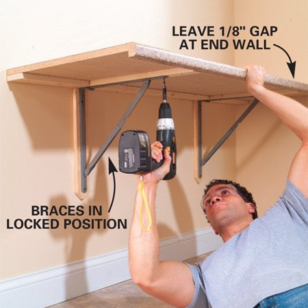 <b>Photo 4: Fasten the top</b></br> Set the top onto the brackets and screw them into the pine cleats (use 1-1/4 in. screws) under the table. Remember to keep about 1/8-in. clearance between the wall and the end for wiggle room as you lift and close the table. This will keep your wall from scarring each time you lift and close the tabletop.