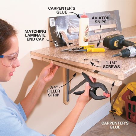 <b>Photo 5: Glue the filler strip</b></br> Glue and screw the 3/4-in. thick filler strips to the exposed bottom edge of the counter. Align the filler strip so it's flush with the edge of the top.