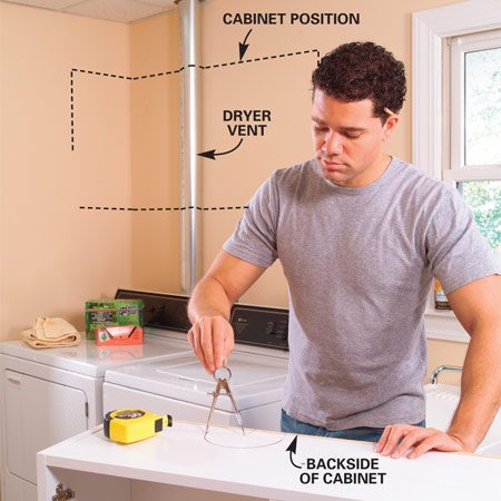 <b>Photo 1: Mark the vent location</b></br> DRAW a 6-in. diameter circle 2 in. in from the back edge of your cabinet to correspond with the location of your dryer vent. Flip the cabinet upside down and draw the same circle to correspond with the top.