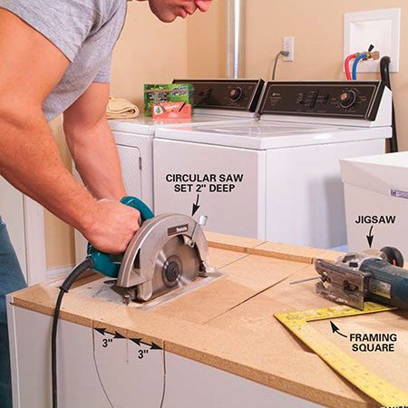 <b>Photo 2: Cut the back of the cabinet</b></br> Cut slots 6 in. apart on the backside of the cabinet that align with the edges of the semicircles. Set your circular saw for a 2-in. depth of cut. Once the back is cut, use a jigsaw to cut along the circles at the top and bottom of the cabinet.