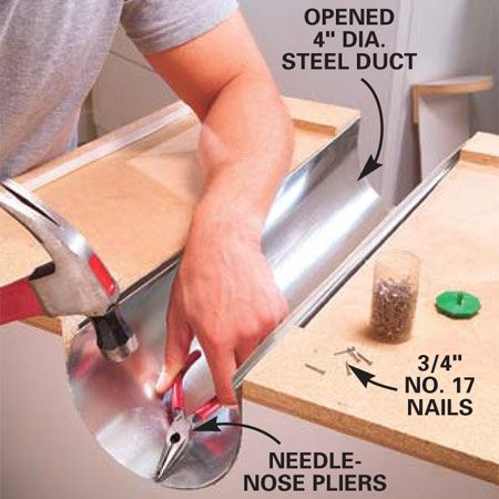 <b>Photo 3: Attach the liner</b></br> Nail a 4-in. steel duct to the cabinet to act as a heat shield for the dryer vent.  Use No. 17 wire nails 3/4 in. long.  This shield will prevent heat buildup inside the cabinet and allow the contents of the cabinet to stay cool.
