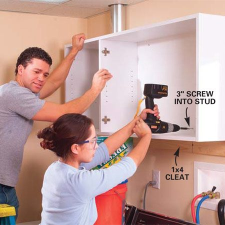 <b>Photo 4: Hang the cabinet</b></br> Level and screw a temporary 1x4 cleat to the wall studs with 2-1/2 in. drywall screws. The cabinet will rest on the cleat and your partner will be able to slide the cabinet left or right to align it. Once you have it where you like it, screw it to the studs with the cabinet screws provided.